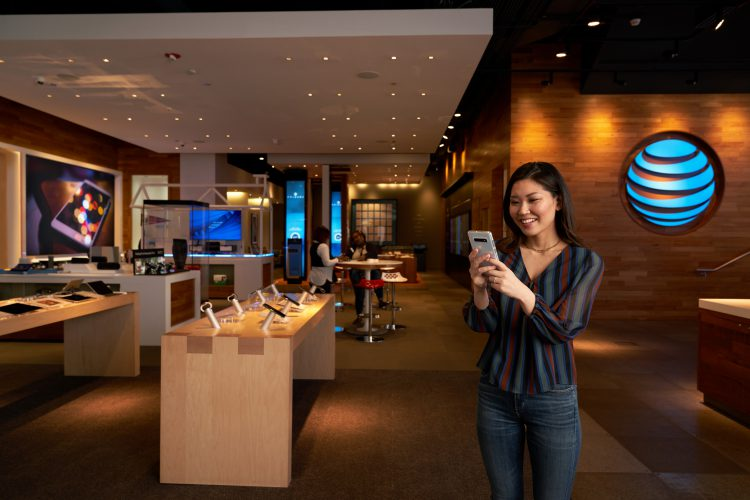 Woman with a phone at an AT&T store